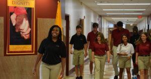Scecina students walk down hallway